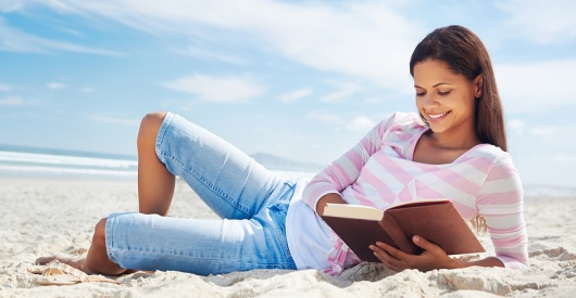 cover image for beta readers showing a woman reading on a beach